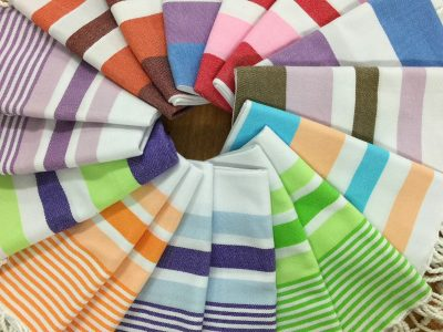 Colourful hand towels in a kaleidoscope of colour Made from organic cotton