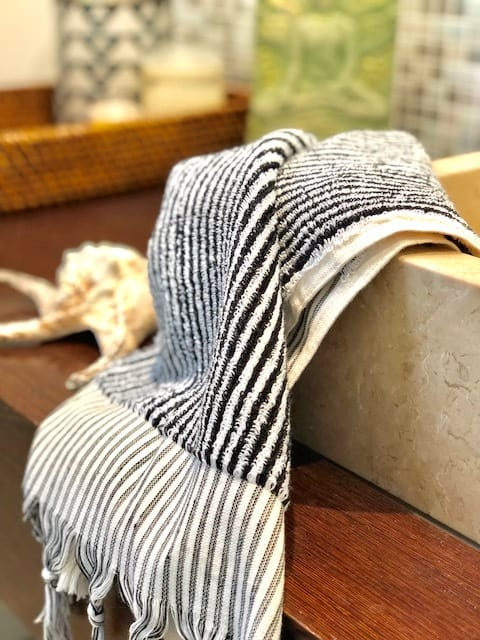 Monochrome striped hand towel made with organic cotton