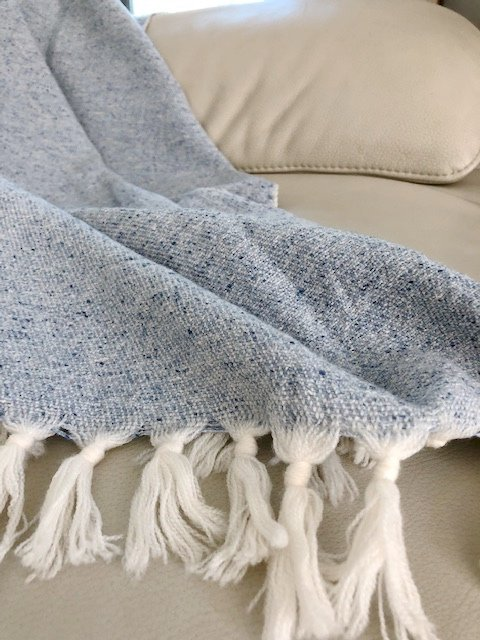 Wool and silk throw rug in a beautiful blue